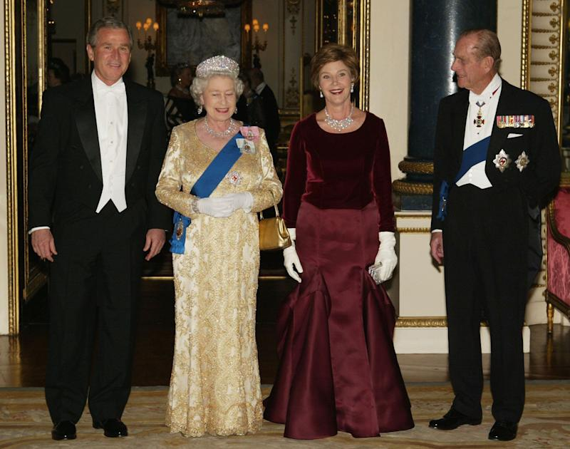 Queen Elizabeth II , U.S. President George W. Bush, First Lady Laura Bush and HRH the Duke of Edinburgh pose in the music room at Buckingham Palace on November 19, 2003 in London.
