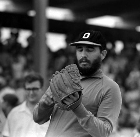 Then Cuban Prime Minister Fidel Castro plays baseball in Havana in this August 1964 file photo. REUTERS/Prensa Latina/File Photo