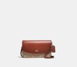 """<p><strong>Coach</strong></p><p>coach.com</p><p><a href=""""https://go.redirectingat.com?id=74968X1596630&url=https%3A%2F%2Fwww.coach.com%2Fproducts%2Fhayden-crossbody-in-signature-canvas%2FC5362.html&sref=https%3A%2F%2Fwww.elle.com%2Ffashion%2Fshopping%2Fg37779639%2Fcoach-sale-bags-2021%2F"""" rel=""""nofollow noopener"""" target=""""_blank"""" data-ylk=""""slk:Shop Now"""" class=""""link rapid-noclick-resp"""">Shop Now</a></p><p><strong><del>$195</del> $146.25 (20% off with code SAVENOW)</strong></p><p>All those TikToks weren't lying: Coach's canvas logo prints are back in a big way. This crossbody's leather flap balances the nostalgic with the classic. </p>"""
