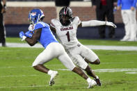 FILE - Mississippi wide receiver Elijah Moore is tackled by South Carolina defensive back Jaycee Horn (1) during the first half of an NCAA college football game in Oxford, Miss., Saturday, Nov. 14, 2020. Horn is a likely first round pick in the NFL Draft, April 29-May 1, 2021, in Cleveland.(AP Photo/Bruce Newman, File)