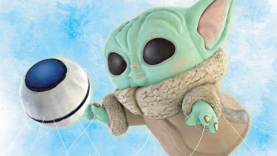 A Funko Pop-like Grogu float chasing after a ball like on The Mandalorian, Grogu at the Macy's Thanksgiving Day Parade.