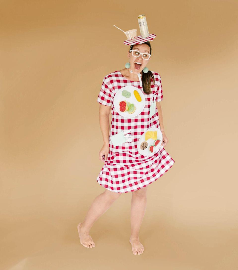 """<p>Fashion a dress from red-and-white gingham fabric (or simply buy one), and embellish it with paper plates, kids' faux foods, and utensils. (Add plastic ants, if desired!) A fascinator made from a paper-covered cardboard disc and more picnic fixin's furthers this feast for the eyes.<strong><br></strong></p><p><strong>Get the tutorial at <a href=""""https://ohyaystudio.com/a-diy-picnic-table-costume-an-homage-to-my-creative-mom/"""" rel=""""nofollow noopener"""" target=""""_blank"""" data-ylk=""""slk:Oh Yay Studio"""" class=""""link rapid-noclick-resp""""><strong>Oh Yay Studio</strong></a>.</strong></p>"""