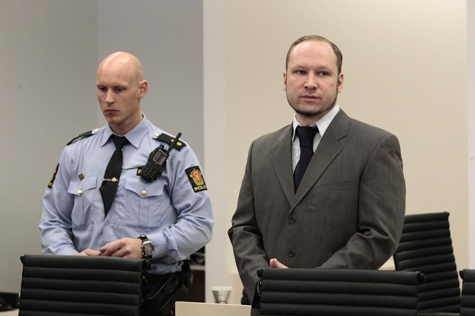 """Mass killer Anders Behring Breivik, right, stands in the courtroom in Oslo, Norway Thursday April 26, 2012. Breivik has slammed a psychiatric report that declared him insane, insisting it was based on """"evil fabrications"""" meant to portray him as irrational and unintelligent. (AP Photo/Hakon Mosvold Larsen/NTB Scanpix, Pool)"""