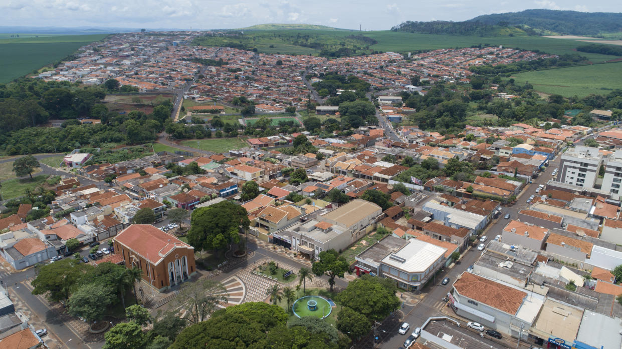 A church, left, stands in Serrana, Sao Paulo state, Brazil, Wednesday, Feb. 17, 2021. Brazil's Butantan Institute has started a mass vaccination on Wednesday of the city's entire adult population, about 30,000 people, to test the virus' behavior in response to the vaccine. (AP Photo/Andre Penner)