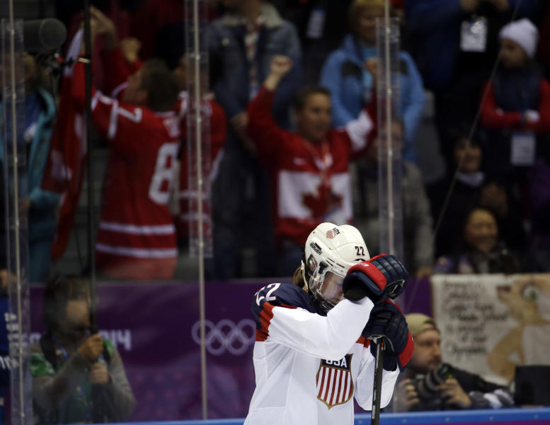 Kacey Bellamy of the United States (22) reacts after Canada won 3-2 in overtime of the gold medal women's ice hockey game at the 2014 Winter Olympics, Wednesday, Feb. 19, 2014, in Sochi, Russia. (AP Photo/David Goldman)