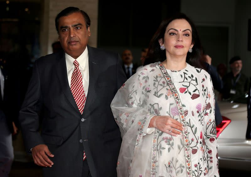 FILE PHOTO: Mukesh Ambani, Chairman and Managing Director of Reliance Industries, arrives with his wife Nita Ambani to address the company's annual general meeting in Mumbai