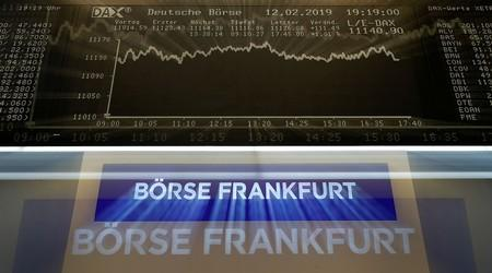 Global stocks gain, dollar weakens after Fed signals possible rate cuts