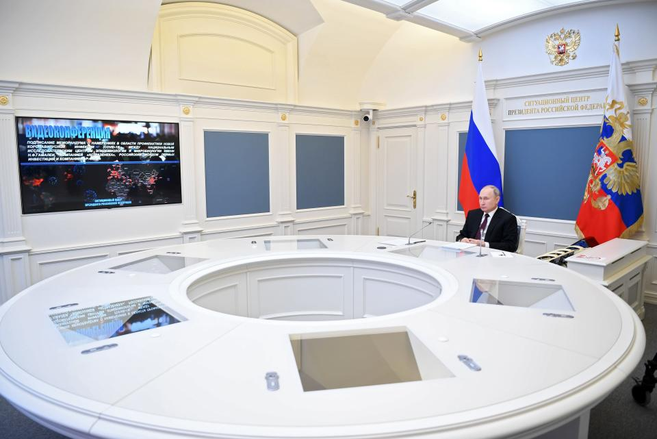 Russian President Vladimir Putin attends a meeting to mark a memorandum of cooperation on the fight against the coronavirus signed between Russia's Gamaleya research center, UK-Swedish pharmaceutical company AstraZeneca, the Russian Direct Investment Fund (RDIF), and R-Pharm pharmaceutical company, via video conference in the Kremlin in Moscow, Russia, Monday, Dec. 21, 2020. (Alexei Nikolsky, Sputnik, Kremlin Pool Photo via AP)