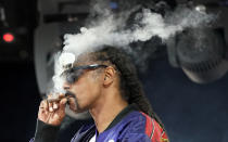 """FILE - Snoop Dogg performs a DJ set as """"DJ Snoopadelic"""" during the """"Concerts In Your Car"""" series on Oct. 2, 2020, in Ventura, Calif. The rapper turns 50 on Oct. 20. (AP Photo/Chris Pizzello, File)"""