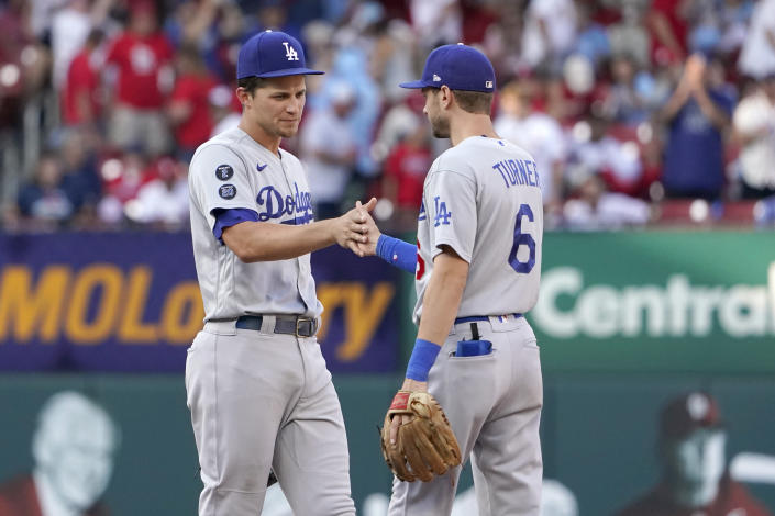 Los Angeles Dodgers' Corey Seager, left, and Trea Turner (6) celebrate a 5-1 victory over the St. Louis Cardinals in a baseball game Monday, Sept. 6, 2021, in St. Louis. (AP Photo/Jeff Roberson)