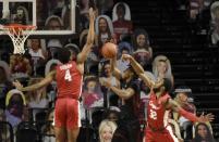 Temple's Khalif Battle (0) takes a shot under the defense on Houstons's Justin Gorham (4) and Reggie Chaney (32) in the first half of an NCAA college basketball game, Saturday, Jan. 23, 2021, in Philadelphia. (AP Photo/Michael Perez)
