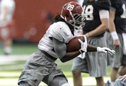 Alabama's Altee Tenpenny works through drills during an Alabama NCAA college football practice, Tuesday, Dec. 16, 2014. (AP Photo/AL.com, Vasha Hunt)