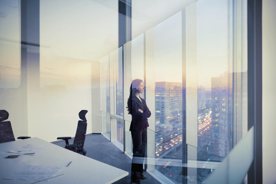 Adult Hispanic woman CEO executive  businesswoman business person in conference meeting room in contemporary modern office daylight sunset dusk talking planning thinking strategy well dressed suit diversity multi-ethnic problems solutions unity cityscape downtown urban new beginnings breaking new ground decisions choices the way forward  contemplation vision focus choices decisions solitude quiet alone