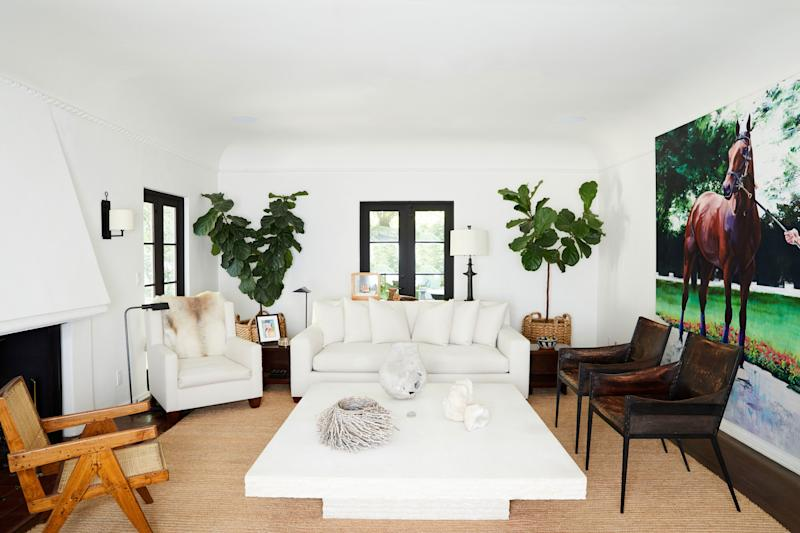 The living room's sofa and matching armchair, as well as the leather-and-iron side chairs, are new pieces inspired by Jean Michel Frank, while the small wooden side tables were built in the '40s by Frank Lloyd Wright for Robert and Rae Levin.