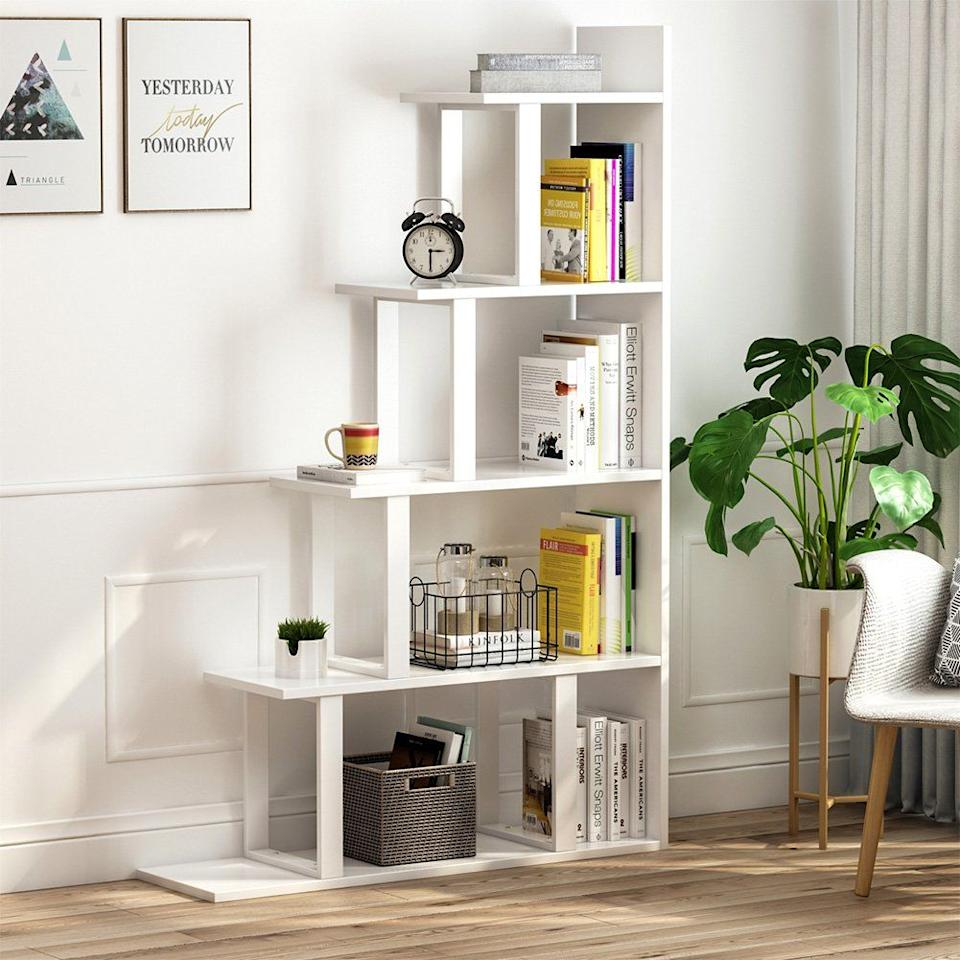 """<h3><a href=""""https://www.walmart.com/ip/Tribesigns-5-Shelf-Ladder-Corner-Bookshelf-Modern-Simplism-Style-White/565348174"""" rel=""""nofollow noopener"""" target=""""_blank"""" data-ylk=""""slk:Tribesigns Corner Ladder Bookshelf"""" class=""""link rapid-noclick-resp"""">Tribesigns Corner Ladder Bookshelf</a> </h3><p>True-kitchen-less apartments can press the flat-back of this ladder bookcase against a wall to create a food space — and then fill the tiered shelves with cooking essentials from favorite cookbooks to tools and snacks.</p><br><br><strong>Tribesigns</strong> 5-Shelf Ladder Corner Bookshelf, $135.48, available at <a href=""""https://www.walmart.com/ip/Tribesigns-5-Shelf-Ladder-Corner-Bookshelf-Modern-Simplism-Style-White/565348174"""" rel=""""nofollow noopener"""" target=""""_blank"""" data-ylk=""""slk:Walmart"""" class=""""link rapid-noclick-resp"""">Walmart</a>"""