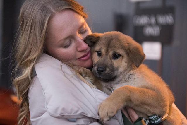 <p>Twenty-three dogs rescued by Humane Society International from a dog meat farm in Ilsan, South Korea, arrive in Washington, DC, on Jan. 5 and 6, 2015. HSI worked with the farmer to remove the dogs from miserable conditions and close the doors of his facility for good. As part of the plan, HSI secured an agreement with him to stop raising dogs for food and move permanently to growing crops as a more humane way to make a living. HSI, the international affiliate of The Humane Society of the United States, is working to reduce the dog meat trade in Asia, including South Korea, where dogs are farmed for the industry. HSI plans to work with more South Korean dog meat farmers to help them transition out of this cruel business. In this image, HSI animal rescue responder Masha Kalinina holds a puppy at Dulles International Airport after his long flight from South Korea. (Kevin Wolf/AP Images for Humane Society International) </p>