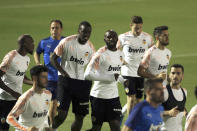 Valencia players run during a training session in Jiddah, Saudi Arabia, Tuesday, Jan. 7, 2020. Valencia will play the Spanish Super Cup semifinal soccer match against Real Madrid at King Abdullah stadium in Jiddah tomorrow. (AP Photo/Amr Nabil)