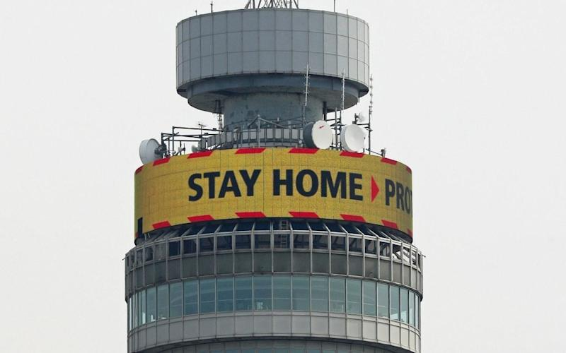The 'Stay Home' slogan, seen displayed on the top of the BT Tower in London - PA