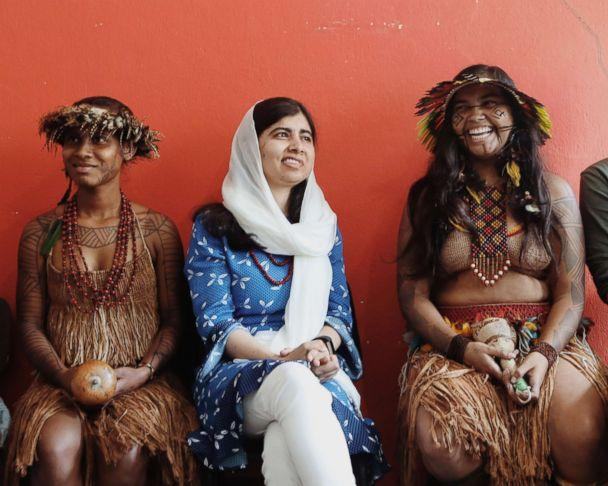 Malala with indigenous Brazilian girls in 2018. (Luisa Dorr/Malala Fund)