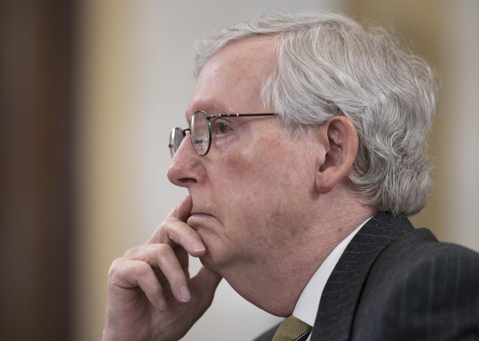 """FILE - In this March 24, 2021, file photo Senate Minority Leader Mitch McConnell, R-Ky., listens as the Senate Rules Committee holds a hearing on the """"For the People Act,"""" which would expand access to voting and other voting reforms, at the Capitol in Washington. Republicans in Congress are making the politically brazen bet that it's more advantageous to oppose President Joe Biden's ambitious rebuild America agenda than to lend support for the costly $2.3 trillion undertaking for roads, bridges and other infrastructure investments. (AP Photo/J. Scott Applewhite, File)"""