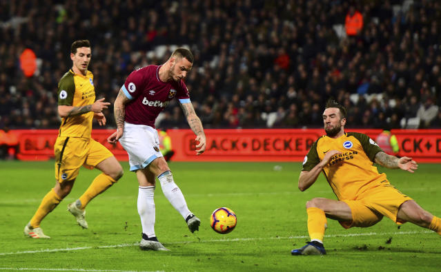 West Ham United's Marko Arnautovic scores his side's first goal against Brighton & Hove Albion during a Premier League soccer match at the London Stadium, Wednesday, Jan. 2, 2019, in London. (Victoria Jones/PA via AP)/PA via AP)