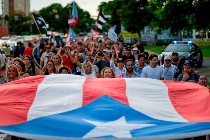 People march in protest in San Juan on July 29, 2019, against the next-in-line for Puerto Rico's governorship, Wanda Vázquez. (Photo: RICARDO ARDUENGO via Getty Images)