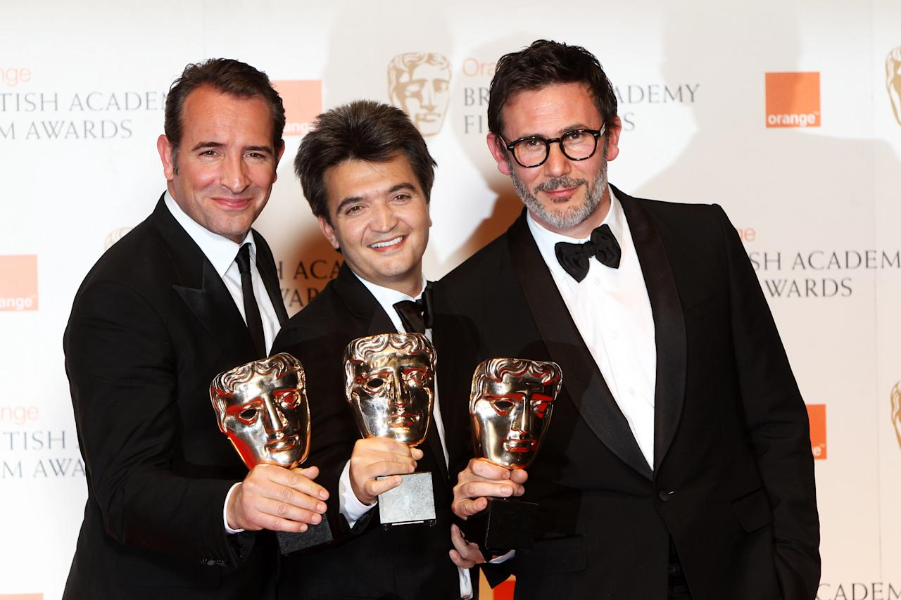 LONDON, ENGLAND - FEBRUARY 12: (UK TABLOID NEWSPAPERS OUT) L-R Jean Dujardin, Thomas Langmann and Michel Hazanavicius pose with their awards for The Artist in the press room at The Orange British Academy Film Awards 2012 at The Royal Opera House on February 12, 2012 in London, England. (Photo by Dave Hogan/Getty Images)