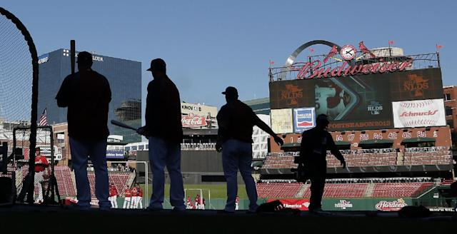 St. Louis Cardinals players warm up in Busch Stadium before Game 5 of a National League baseball division series between the Cardinals and the Pittsburgh Pirates on Wednesday, Oct. 9, 2013, in St. Louis. (AP Photo/Charlie Riedel)