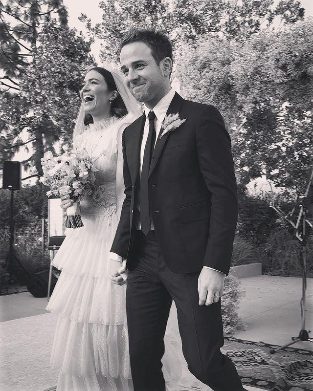 "<p>They held their intimate wedding in Mandy's Pasadena, CA backyard. ""It was boho chic and very romantic,"" a source told <em><a href=""https://people.com/tv/mandy-moore-taylor-goldsmith-wedding-photos/"" rel=""nofollow noopener"" target=""_blank"" data-ylk=""slk:People"" class=""link rapid-noclick-resp"">People</a></em>. There was pink décor, feathers, flower arrangements, and candles. And, Mandy's wedding gown was pink.</p><p>Then, Mandy changed into a black dress for the reception at Fig House in Los Angeles. ""It was a fun and very relaxed reception,"" a source told the publication. ""Guests eat, drank and danced. Mandy looked ecstatic and stunning."" Mandy and her new husband performed together on stage.</p><p><a href=""https://www.instagram.com/p/BqYGsWfAcbt/"" rel=""nofollow noopener"" target=""_blank"" data-ylk=""slk:See the original post on Instagram"" class=""link rapid-noclick-resp"">See the original post on Instagram</a></p>"