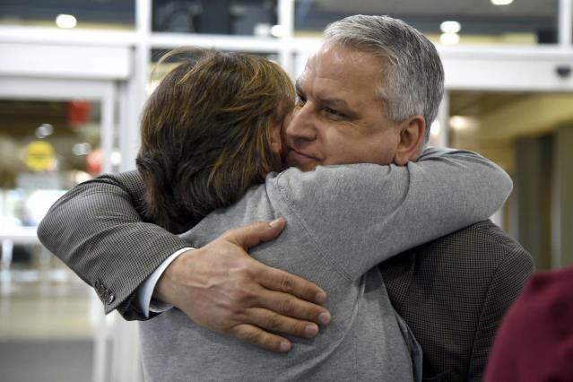 <p>Jim Demetros hugs his wife Cindy as she arrives from their home in Connecticut to pick him at Philadelphia International Airport, Tuesday, April 17, 2018, after his Southwest Airlines plane landed with a damaged engine. (Photo: Tom Gralish/The Philadelphia Inquirer via AP) </p>