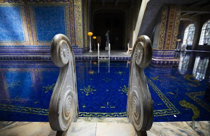 SAN SIMEON, CA - OCTOBER 06: The pool ladders are made of marbel in the Roman Pool at Hearst Castle. It is a tiled indoor pool decorated with eight statues of Roman gods, goddesses and heroes on Tuesday, Oct. 6, 2020 in San Simeon, CA. Hearst Castle, one of California's most popular tourist attractions, has temporarily suspended their tours since mid-March due to the global coronavirus pandemic. (Francine Orr / Los Angeles Times)
