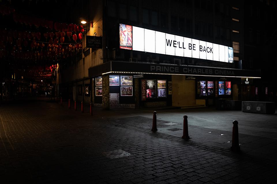 "A sign reading ""We'll Be Back"" is seen on the Prince Charles cinema near Leicester Square on March 20, 2020. (Photo by Leon Neal/Getty Images)"
