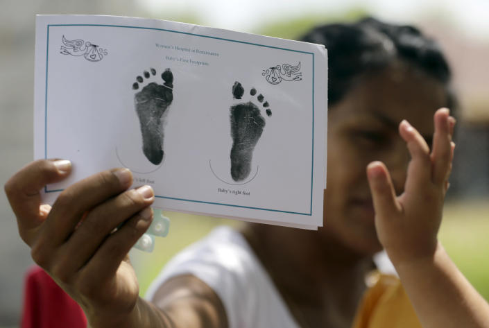 A woman in Sullivan City, Texas, who said she entered the country illegally shows the footprints of her daughter, who was born in the United States but was denied a birth certificate, on Sept. 16, 2015. (Photo: Eric Gay/AP)