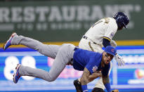 Chicago Cubs shortstop Javier Baez, below, forces out Milwaukee Brewers center fielder Jackie Bradley Jr. at second base during the second inning of a baseball game Wednesday, June 30, 2021, in Milwaukee. (AP Photo/Jeffrey Phelps)