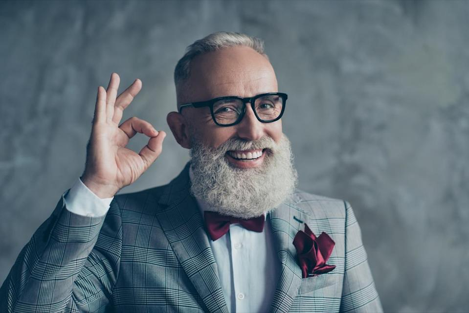 Close up portrait of funny excited cheerful with groomed stylish moustache hipster grandfather sharp-dressed checkered jacket burgundy tissue in pocket making ok symbol isolated on grey background