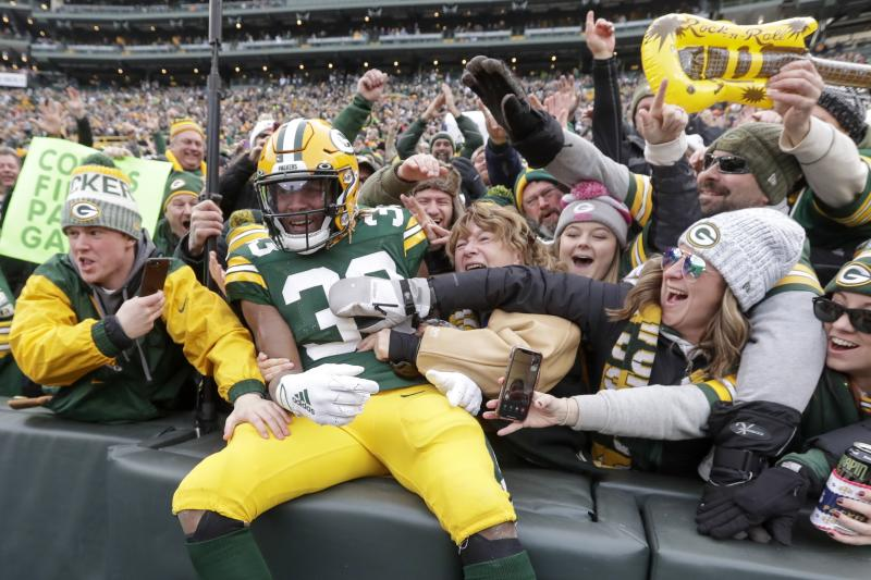 Green Bay Packers' Aaron Jones celebrates with fans after running for a touchdown during the first half of an NFL football game against the Washington Redskins Sunday, Dec. 8, 2019, in Green Bay, Wis. (AP Photo/Morry Gash)