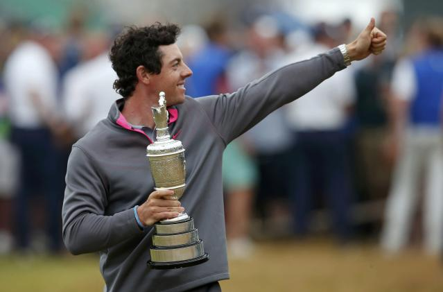 Rory McIlroy of Northern Ireland celebrates as he holds the Claret Jug after winning the British Open Championship at the Royal Liverpool Golf Club in Hoylake, northern England July 20, 2014. REUTERS/Cathal McNaughton (BRITAIN - Tags: SPORT GOLF)