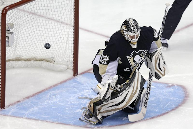 A shot by Boston Bruins' Brad Marchand gets past Pittsburgh Penguins goalie Tomas Vokoun for a goal in the first period of Game 2 of the NHL hockey Stanley Cup playoffs Eastern Conference finals, in Pittsburgh on Monday, June 3, 2013. (AP Photo/Gene J. Puskar)