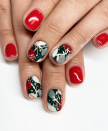 "<p>Instead of going for an all-red classic Christmas manicure, add in a chic holly green design on a nail (or two) like <a href=""https://www.instagram.com/p/B5sbMN4BBIo/"" rel=""nofollow noopener"" target=""_blank"" data-ylk=""slk:Henson did here"" class=""link rapid-noclick-resp"">Henson did here</a> for artistic flair.</p><p><a class=""link rapid-noclick-resp"" href=""https://go.redirectingat.com?id=74968X1596630&url=https%3A%2F%2Fwww.etsy.com%2Flisting%2F861263199%2Fmidnight-stroll-floral-print-nail-wraps&sref=https%3A%2F%2Fwww.oprahmag.com%2Fbeauty%2Fg34113691%2Fchristmas-nail-ideas%2F"" rel=""nofollow noopener"" target=""_blank"" data-ylk=""slk:SHOP NAIL WRAPS"">SHOP NAIL WRAPS</a></p>"