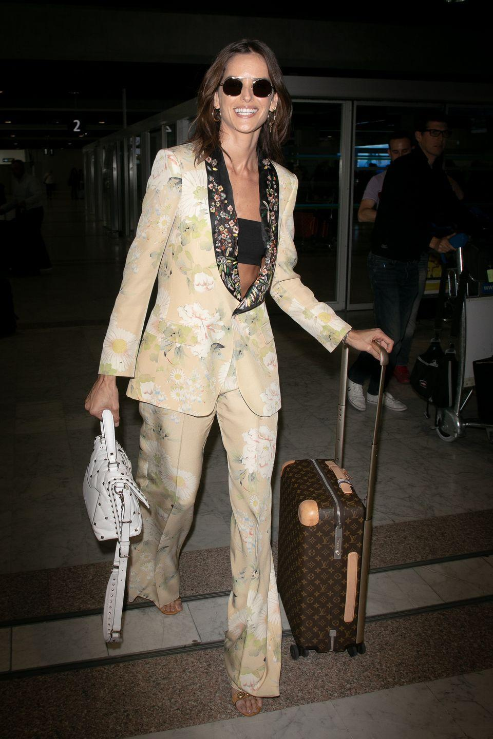 <p><strong>Izabel Goulart, 2019: </strong>The model wore a bralette underneath a floral pantsuit set as she landed in Nice for the 72nd annual Cannes Film Festival. </p>