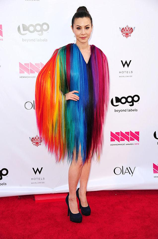 "We love that ""Work of Art"" hostess with the mostest China Chow took a fashion risk while supporting the LGBT community at this year's NewNowNext Awards in a rainbow-hued frock, but we can't back any garment that features the hair of a shaved Fraggle. (4/5/2012)"