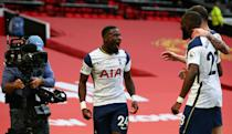 MANCHESTER, ENGLAND - OCTOBER 04: Serge Aurier of Tottenham Hotspur celebrates with teammates Tanguy Ndombele and Pierre-Emile Hojbjerg after scoring his sides fifth goal during the Premier League match between Manchester United and Tottenham Hotspur at Old Trafford on October 04, 2020 in Manchester, England. Sporting stadiums around the UK remain under strict restrictions due to the Coronavirus Pandemic as Government social distancing laws prohibit fans inside venues resulting in games being played behind closed doors. (Photo by Alex Livesey/Getty Images)
