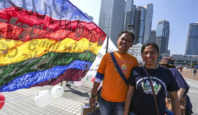 Ivan Delfin and Ivy Alamid, who have been together for nine years, join the pride event. Photo: Jonathan Wong