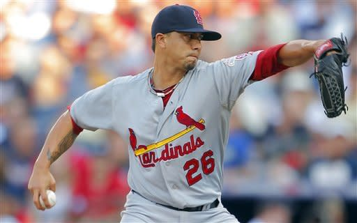 St. Louis Cardinals starting pitcher Kyle Lohse (26) works during the first inning of the National League wild card playoff baseball game against the Atlanta Braves, Friday, Oct. 5, 2012, in Atlanta. (AP Photo/Todd Kirkland)