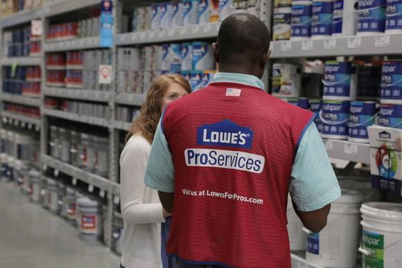 Lowe's Pro Services employee talking to customer