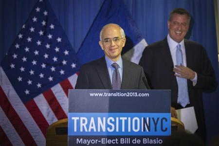 Anthony Shorris reacts after being teased about his height during the announcement by New York Mayor elect Bill de Blasio that Shorris will be the incoming administration's First Deputy Mayor in New York