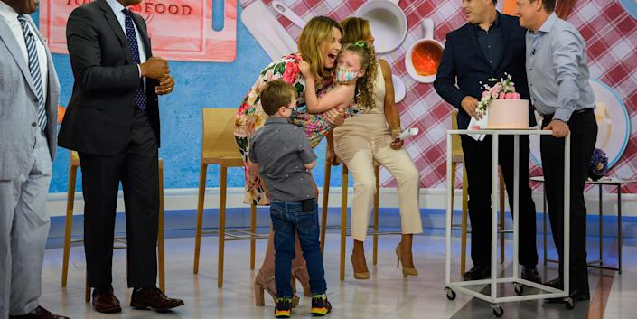 Hugs all around! Savannah Guthrie got a surprise visit from her children, Vale, 6, and Charley, 4, to celebrate her 10th anniversary on TODAY.  (Nathan Congleton / TODAY)