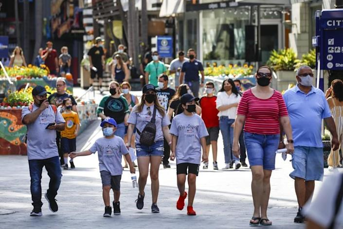 Universal City, CA - June 15: There were many mask wearers as people packed Universal City Walk, in Universal City, CA, Tuesday, June 15, 2021, as the state of California celebrates the end of pandemic-era restrictions, including mask wearing in most situations. (Jay L. Clendenin / Los Angeles Times)