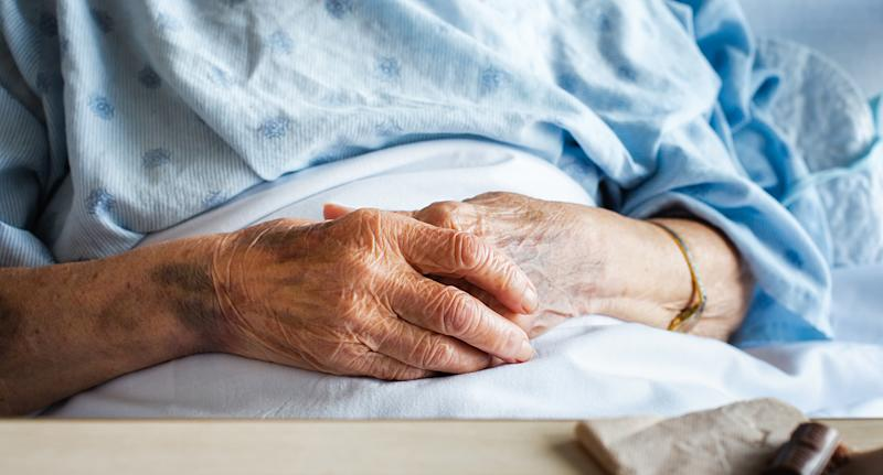 The hands of an elderly person in hosptial.