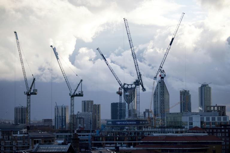 Britain's economy enjoyed a vigorous rebound in the third quarter as lockdowns were eased, but a surge in virus infections and renewed restrictions are dark clouds on the economic horizon